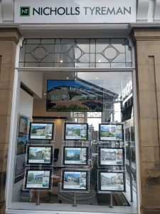 Digital Signage Screen in Estate Agents Window